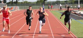 Rett Dittfurth leans across the finish line to claim second place in the 100 meter dash at an area meet in Springtown Wednesday.    Photo by Dr. Chet Martin