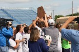 Stephenville athletic director Mike Copeland presents trophy