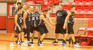 Coach Travis Stilwell meets the Yellow Jacket varsity summer team as they come off the court for a brief break during their 36-6 win over host Glen Roses at Tiger Arena Thursday evening. || Photo by THE FLASH TODAY