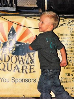 Sundown on the Square music Boy dancing