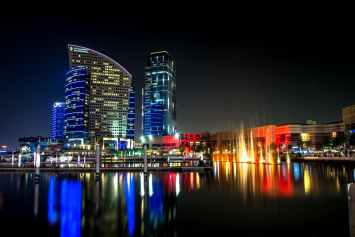 night buildings reflections dubai