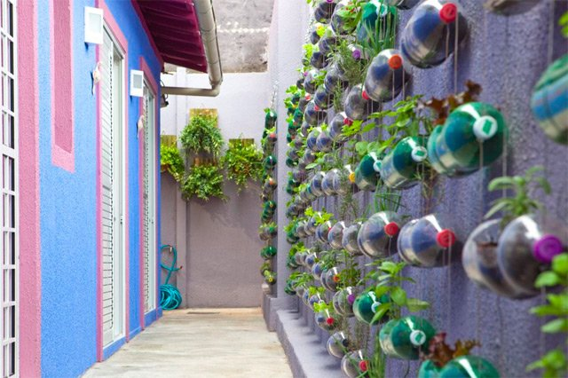 Vertical Garden Built From Hundreds of Recycled Soda Bottles via This is Colossal