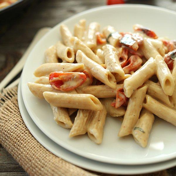 Creamy Vegan Garlic Pasta with Roasted Tomatoes by Minimalist Baker