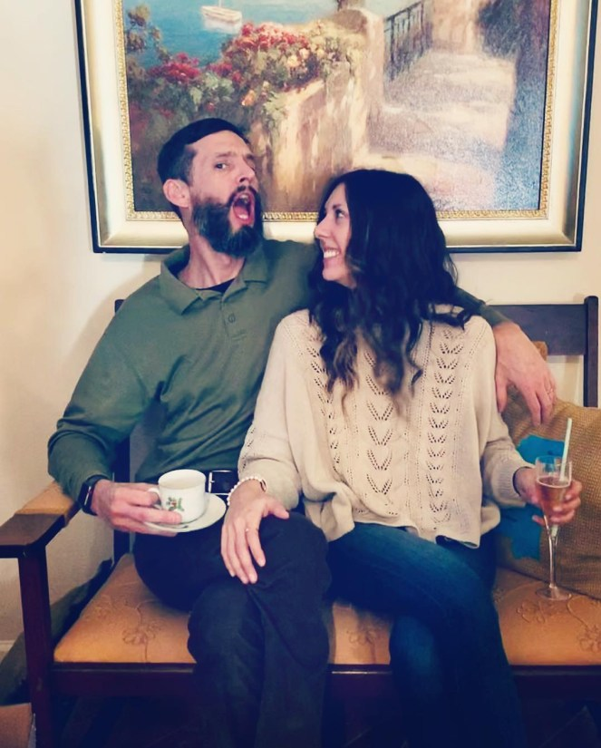 happy married couple laughing fun spell & the gypsy linda slouch knit christmas shenanigans