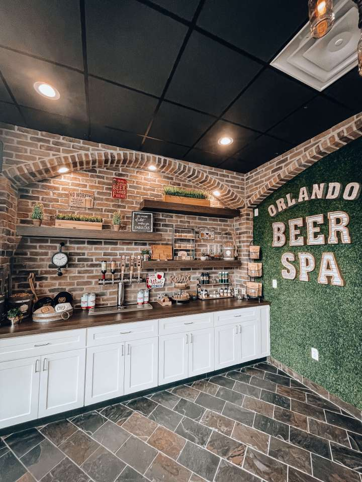 The Orlando Beer Spa front lobby area with beer, skincare items, hair care items, and wine
