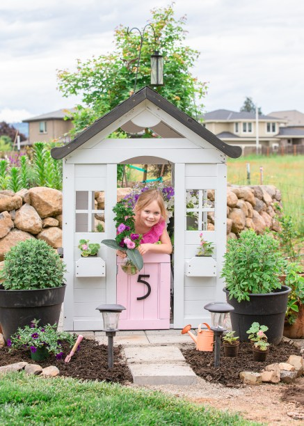 playing inside modern farmhouse playhouse