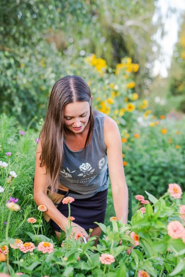 Jen from The Flowering Farmhouse harvesting zinnia flowers