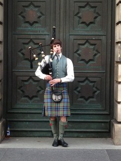 Bagpipers in Scotland