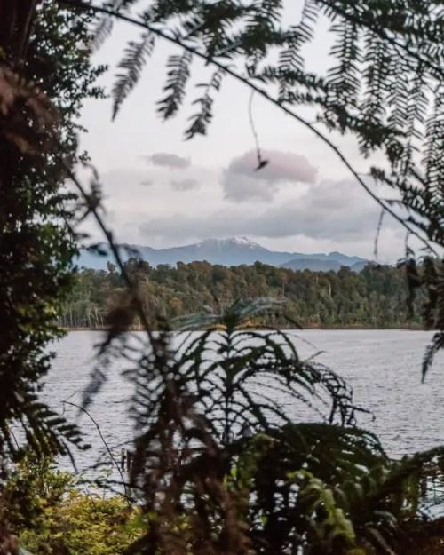 When you explore New Zealand, don't miss Lake Mahinapua in Hokitika with stunning mountain views.