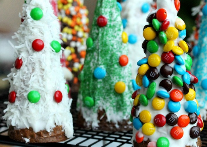 Decorate upside-down waffle cones to make Christmas tree desserts
