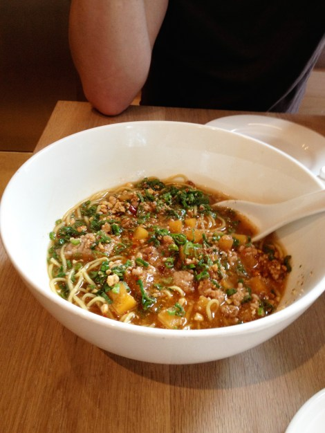 A bowl of ramen noodles called Dan dan Mein from Momofuku with pork, dried scallops and peanuts.