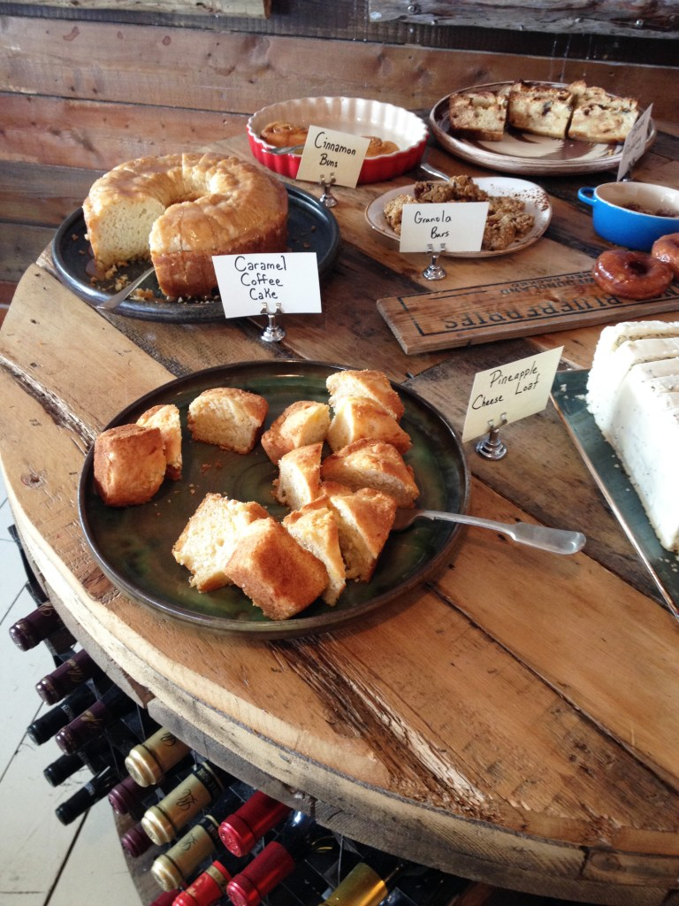 A round table full of pastries and desserts.