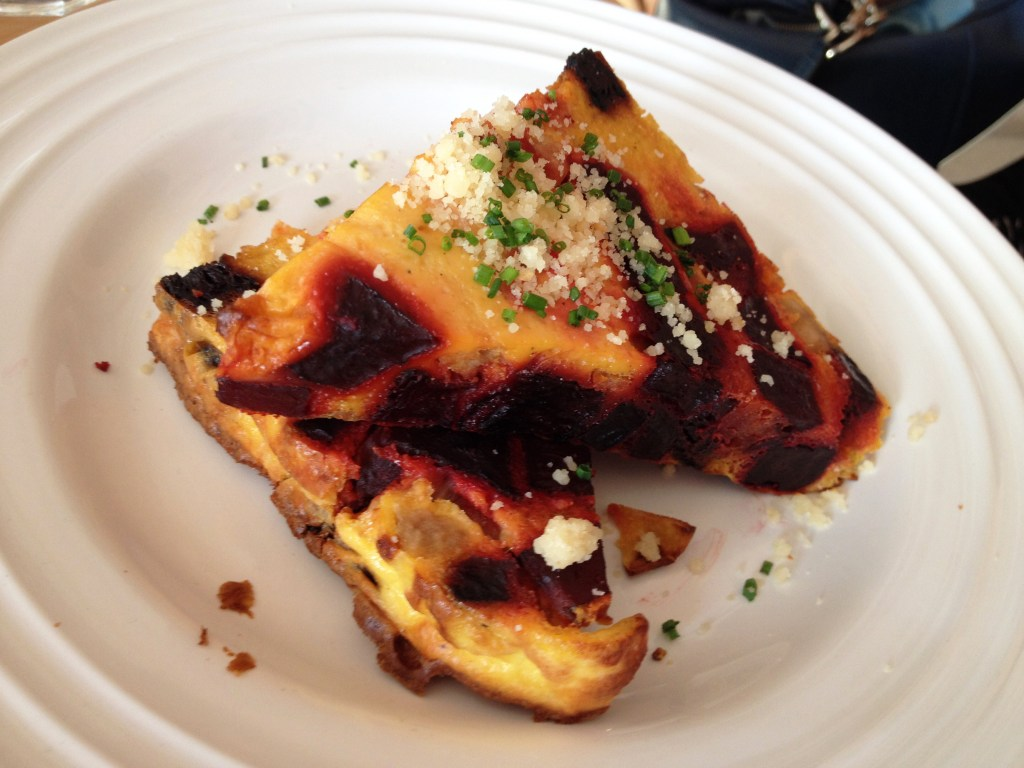 A plate of Frittata with beet and onion.