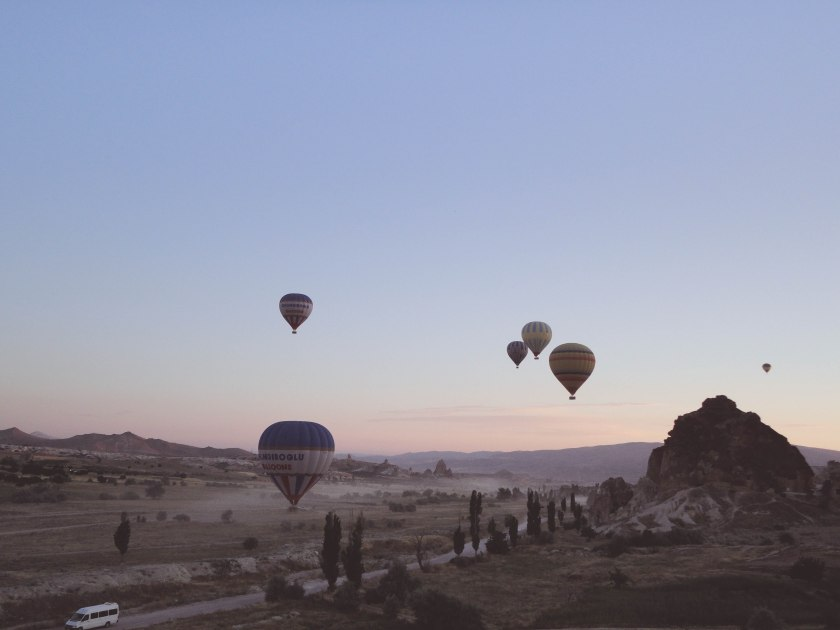 Watching the sunrise from a hot air balloon is probably one of the coolest things to do in Cappadocia.