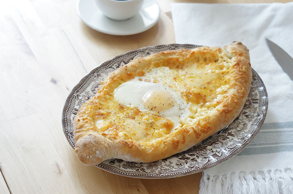 Khachapuri on table with coffee