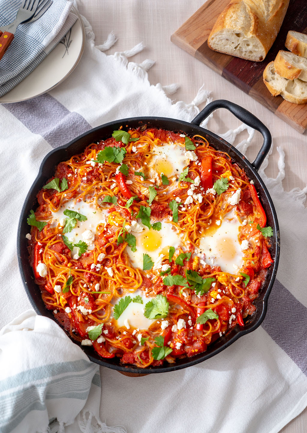 Shakshuka Spaghetti bake in a cast iron frying pan