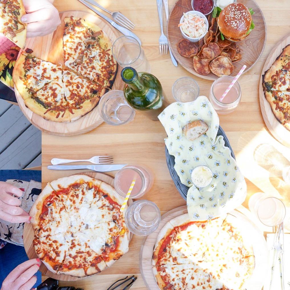Newfoundland Restaurants: an overhead picture of pizzas on a table at Bonavista Social Club