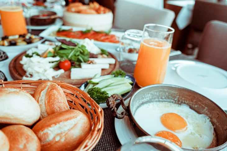 fried egg beside bread platter