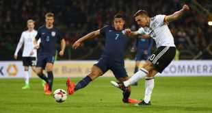 Lucas Podolski fires Germany ahead in a friendly match against England in Dortmund