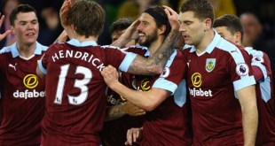 George Boyd celebrates with his Burnley teammates after scoring against Stoke