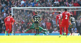 Fraser Forster saves a penalty from James Milner