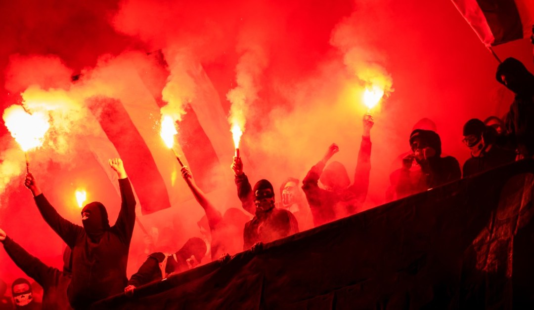 Football supporters holding flares