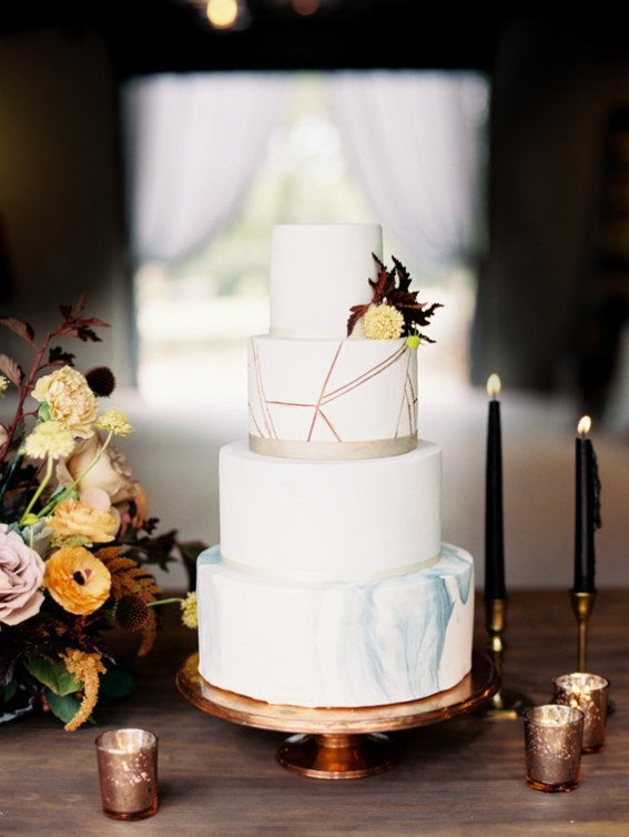 A beautifully elegant and modern fall wedding cake adorned with ribbon and trendy marble