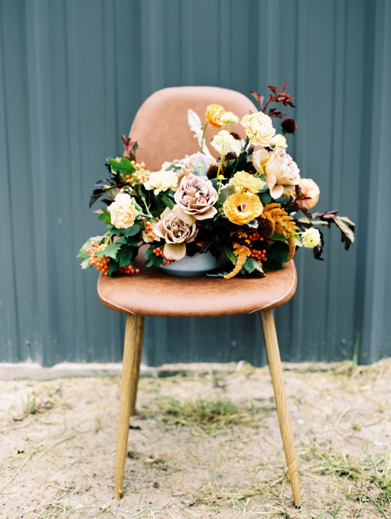 Minimal modern fall wedding details including rustic warm florals and tones.
