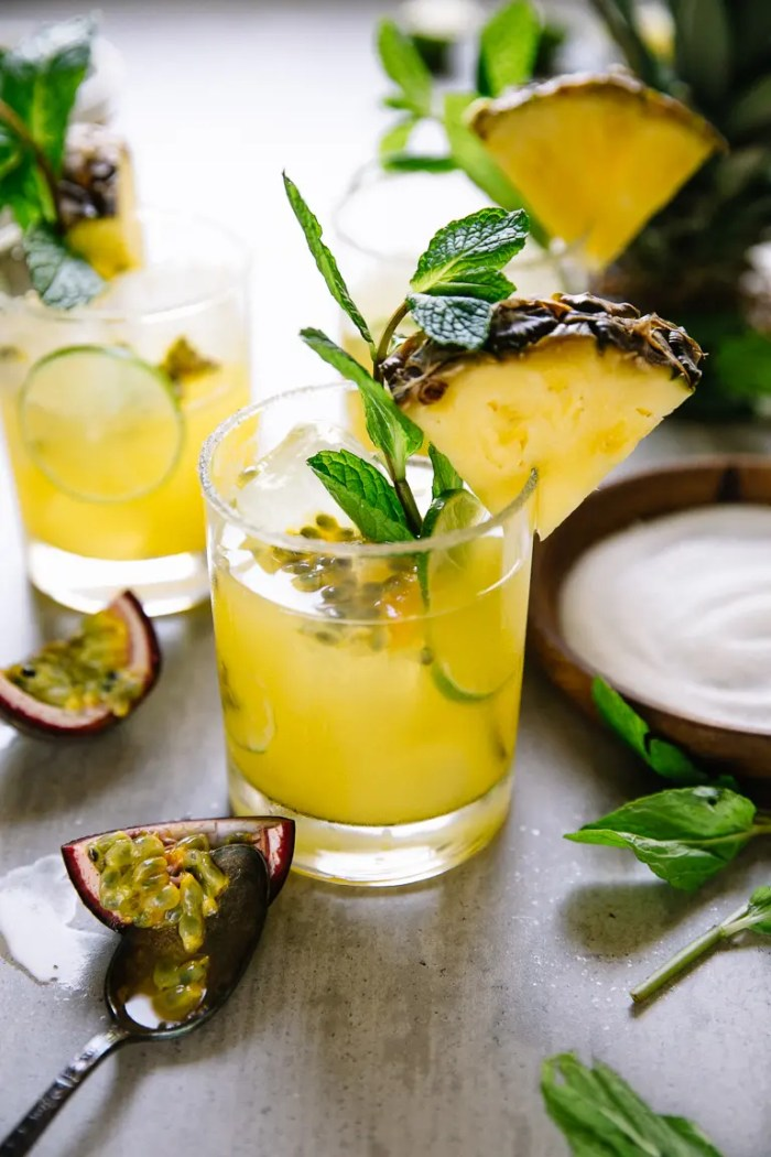 Garnished Passion Fruit Pineapple Margaritas on a table