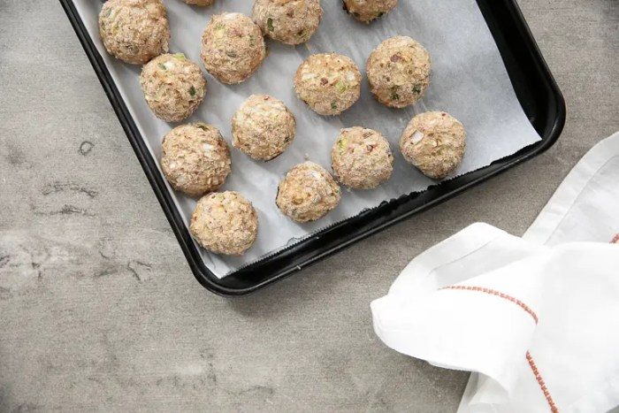 Fully cooked meatballs on tray ready to place in the freezer