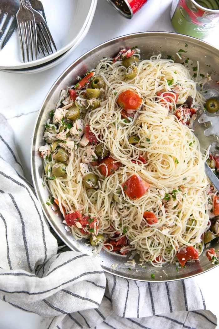 Angel Hair Pasta tossed with chicken, green olives, tomatoes, and fresh parsley