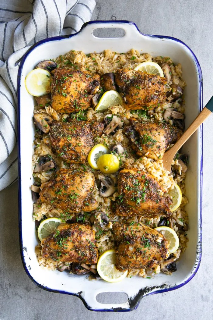 Casserole dish filled with cajun rice and chicken thighs