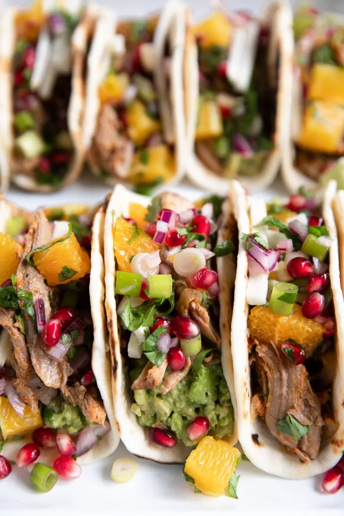Flour tortillas filled with shredded harissa lamb, pomegranate orange salsa, and avocado.