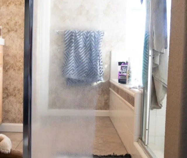 Glshower Door With Half Of The Hard Water Stains Removed And The Other Left As