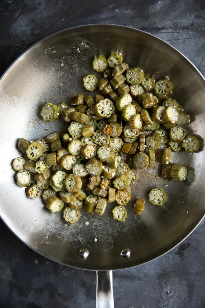 Fried chopped okra in a skillet.