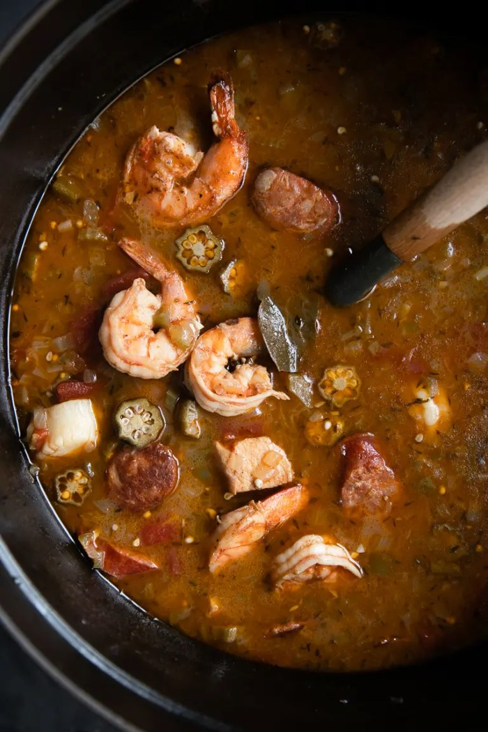 Large pot filled with chicken, sausage, seafood, and okra Gumbo.