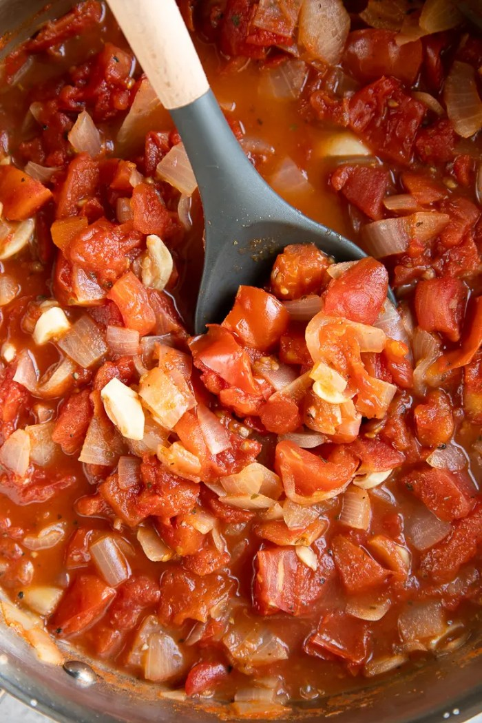 Simmering ingredients in a pot for homemade marinara sauce.