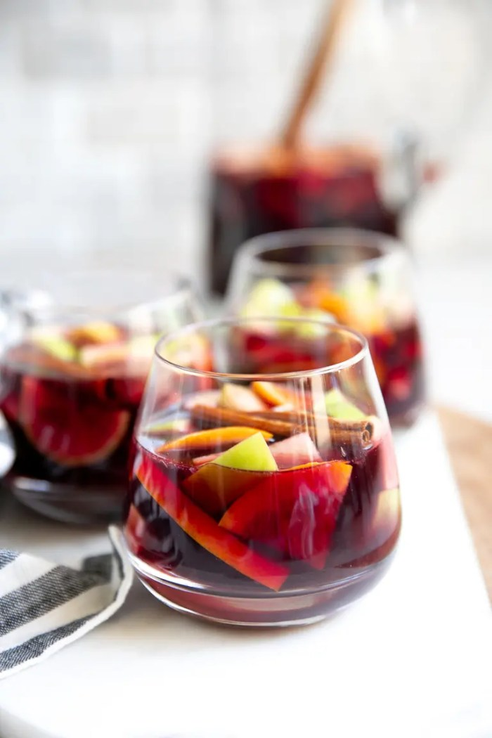 Three glasses and a pitcher of classic sangria.
