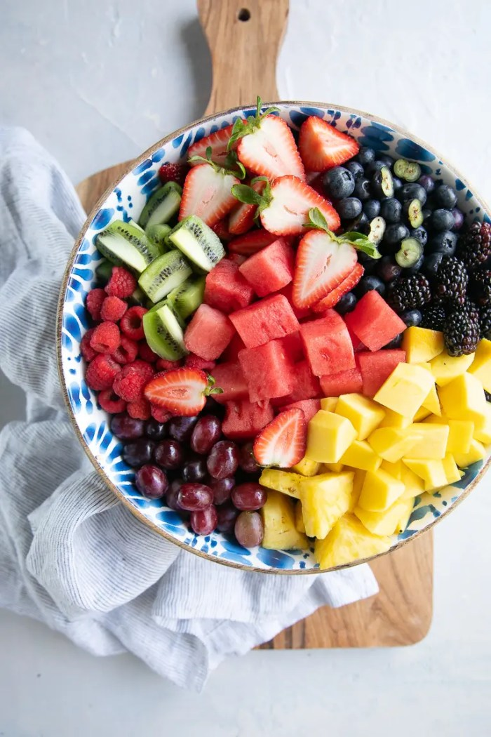 Chopped up chunks of fruit in a large mixing bowl.
