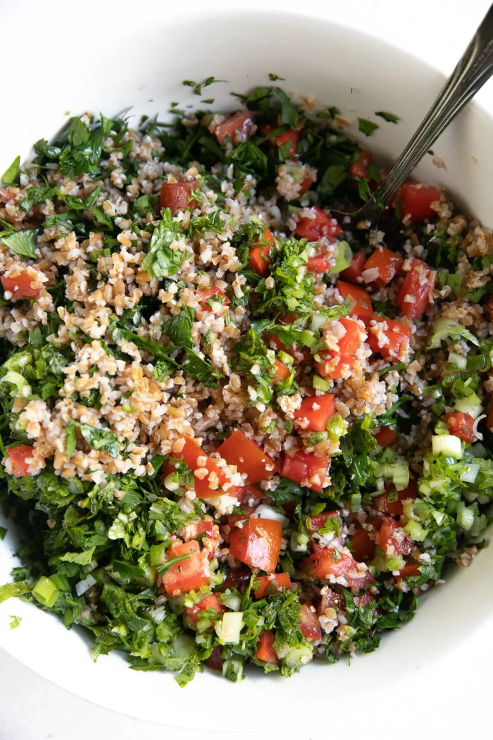 Partially mixed together tabouli salad.