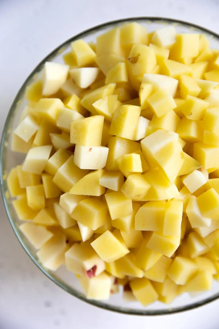 Glass bowl filled with diced potatoes