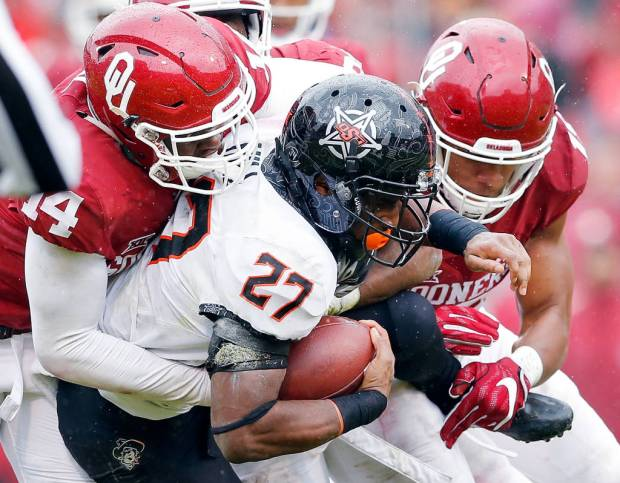 Oklahoma State's Justice Hill finished with 99 yards rushing against Oklahoma in OU's 38-20 Bedlam victory Saturday, but had only 7 yards in the second half. (PHOTO: Ty Russell/OU media relations)