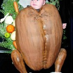 Baby girl dressed as a cooked turkey