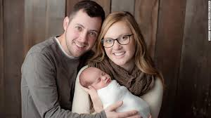 Tina Gibson, Benjamin Gibson and their special baby.