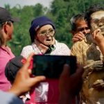 The village where they take selfies with mummies