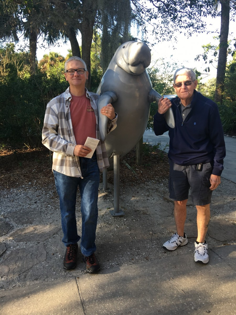 Holding Flippers With The Manatee Statue