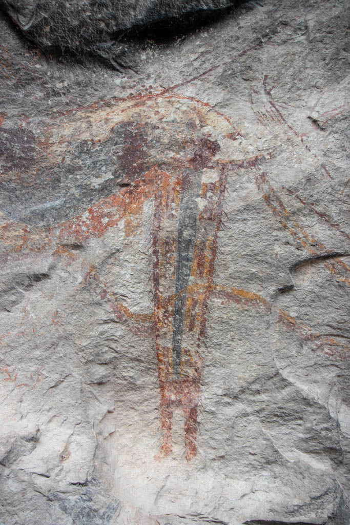 Shaman Figure With Wavy Line Through It