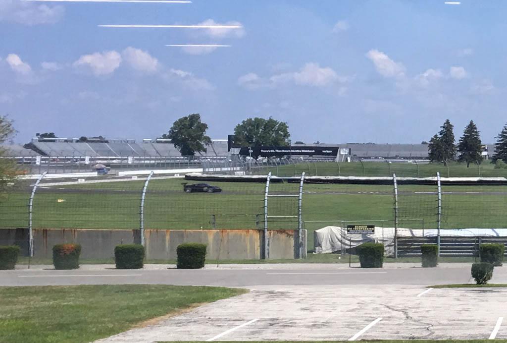 Ferrari Racing On The Infield Track