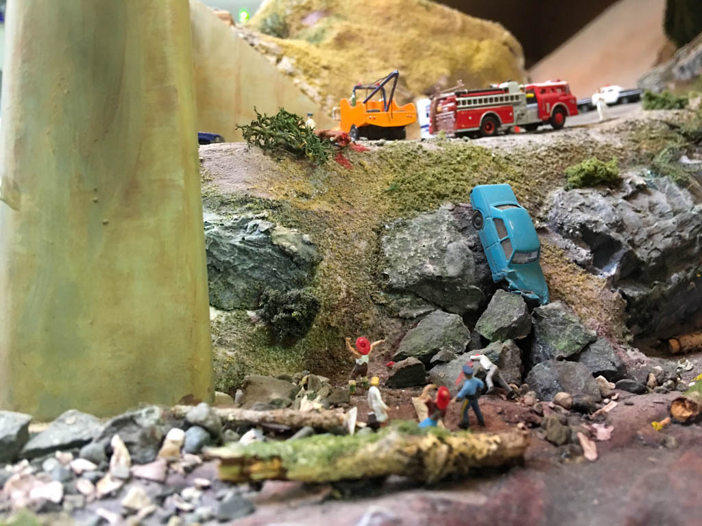 Victim Face Down On Rock Below Wrecked Car