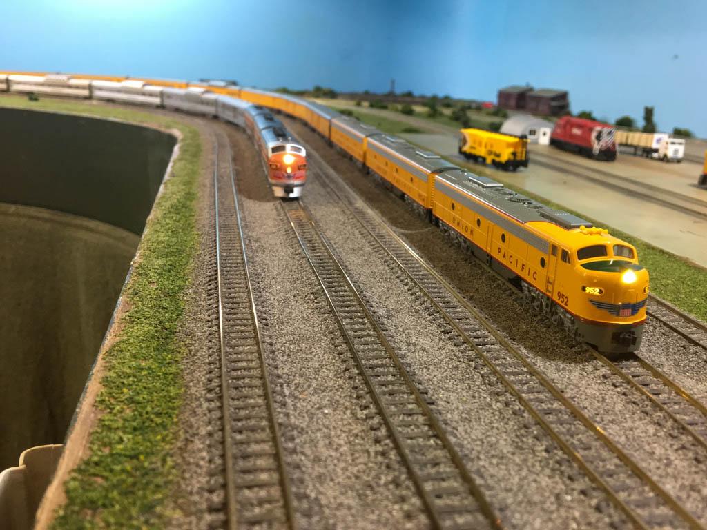 Passenger Train Overtakes Freight Train